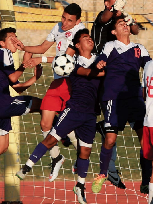 Bel Air goalie Frank Rodriguez, top right, and defender Julio Melgoza, center left in white, turned away a shot by Eastlake's Allan Navarro, right, during the second half on Monday.