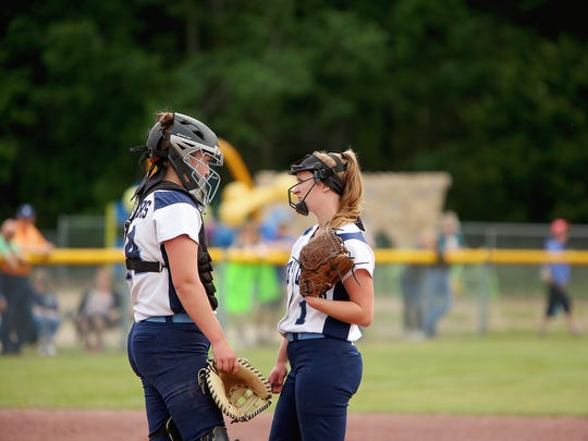 Pine Plains' Catherine Simmons, left, and Alex McKenzie meet at the mound during Saturday's semifinal win over Greenville.