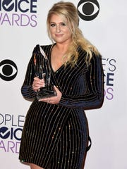 Meghan Trainor poses with her favorite album trophy