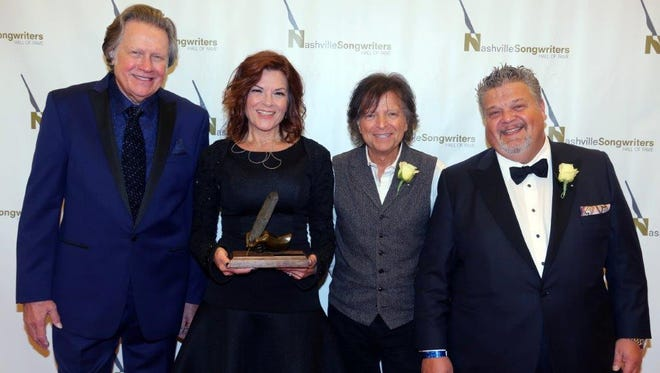 Mark James, left, Rosanne Cash, Even Stevens and Craig Wiseman are pictured before their induction into the Nashville Songwriters Hall of Fame on Sunday.