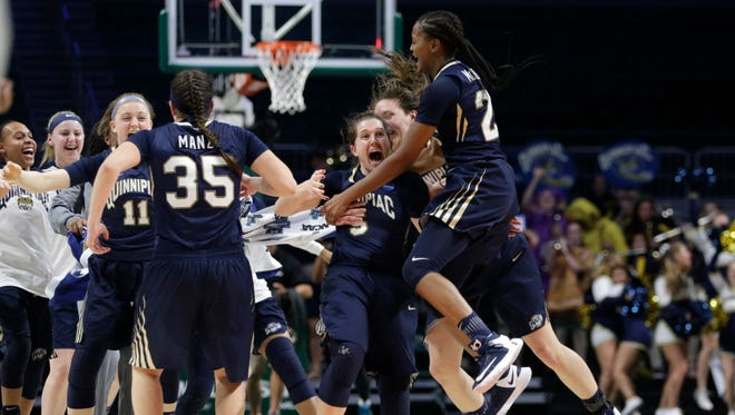 Quinnipiac's Carly Fabbri (5) celebrates with Morgan Manz (35) and Aryn McClure, right, after a second-round win over Miami.