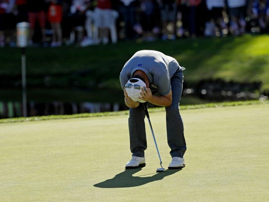 Europe's Andy Sullivan reacts after missing his putt on the 15th hole during a singles match at the Ryder Cup golf tournament Sunday, Oct. 2, 2016, at Hazeltine National Golf Club in Chaska, Minn. (AP Photo/David J. Phillip)