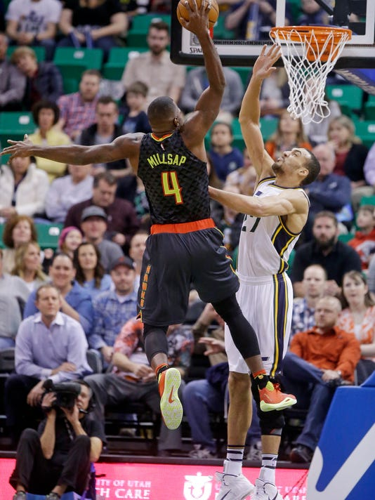 Atlanta Hawks forward Paul Millsap (4) goes to the basket as Utah Jazz center Rudy Gobert (27) defends during the first quarter of an NBA basketball game Tuesday, March 8, 2016, in Salt Lake City. (AP Photo/Rick Bowmer)