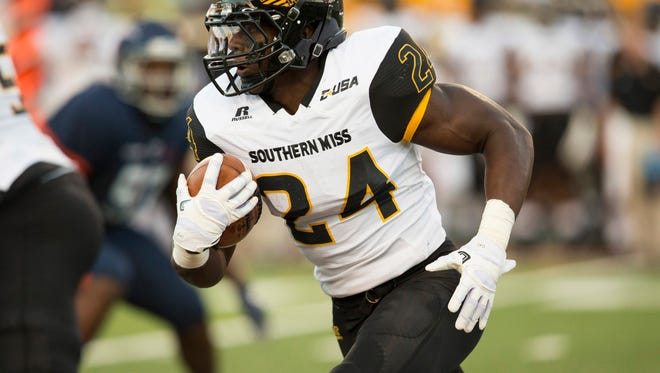 Southern Miss running back George Payne runs the ball against the UTEP Miners on Saturday at Sun Bowl Stadium in El Paso, Texas.