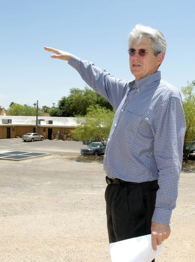 SouthBridge developer Fred Unger stands on a dirt patch where the new development will be along the south side of the Arizona Canal.  Unger's next phase will be a residential development along the canal on both sides of Goldwater Boulevard in Scottsdale.