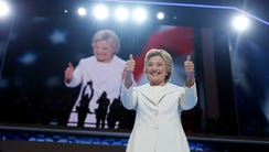 Hillary Clinton gives her thumbs up as she appears
