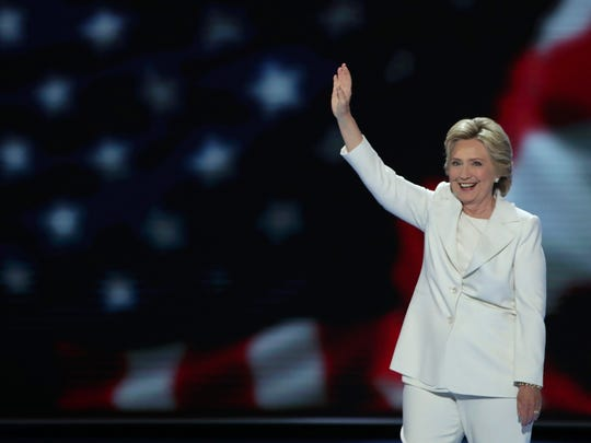 Democratic presidential nominee Hillary Clinton waves to the crowd as she arrives on stage during the fourth day of the Democratic National Convention at the Wells Fargo Center, July 28, 2016 in Philadelphia, Pennsylvania.