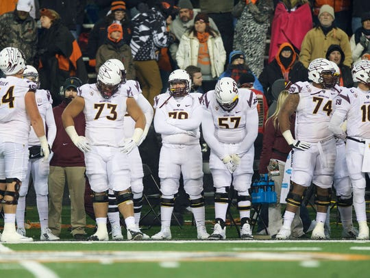 The Arizona State football team watch from the sidelines