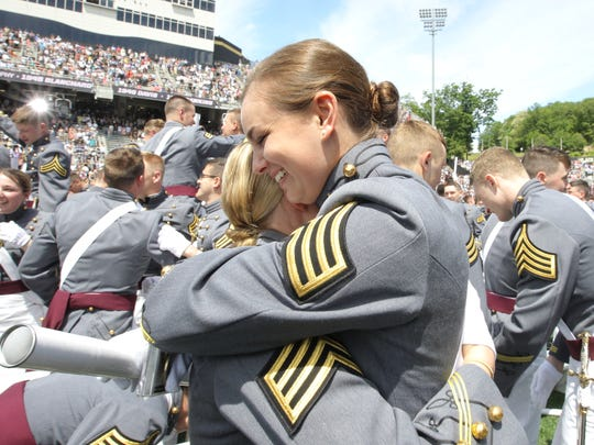 Cadets embrace after their graduation ceremony for the Class of 2017 at The  United States Military Academy at West Point on Saturday, May 27, 2017.