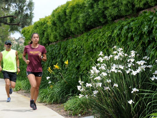 Samantha Barajas, senior at Simi Valley High School goes on her 4-mile run with her father and coach Jorge Barajas. She's one of the top distance runners in Ventura County, having also shined in cross country.