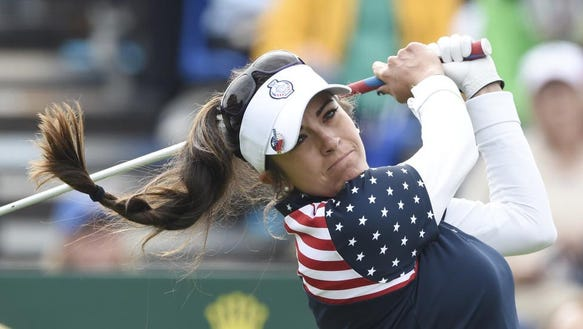 United States' Gerina Mendoza Piller tees off in the