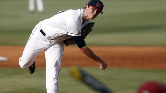 Mississippi pitcher Chris Ellis pitches to a Jacksonville State batter during the third inning of an NCAA college baseball regional tournament game in Oxford, Miss., Saturday, May 31, 2014. (AP Photo/Rogelio V. Solis)