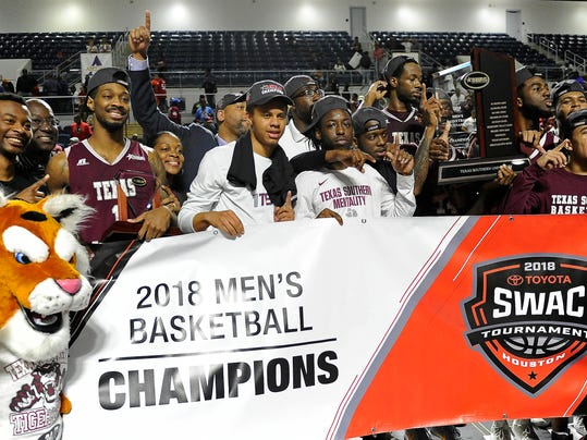 Texas Southern basketball players pose with the champion's trophy after their win over Arkansas-Pine Bluff in an NCAA college basketball game in the championship of the Southwestern Athletic Conference, Saturday, March 10, 2018, in Houston. (AP Photo/Eric Christian Smith)