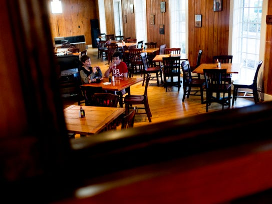 The dining hall is reflected in a mirror at Troubadour Roadhouse and Performance Hall in Knoxville, Tennessee, on Thursday, February 1, 2018. The restaurant at 4705 Old Kingston Pike features a full bar, dining hall and a performance stage for music and live acts.