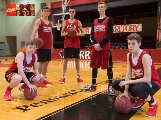 Pensacola Christian Academy basketball players, L to R, Austin Lewis, Patrick Murphy, Alex Dickerman, Cole Riegsecker, and Joe Bertram, are preparing for the Warrior's third run at the Region 1-3A championships.