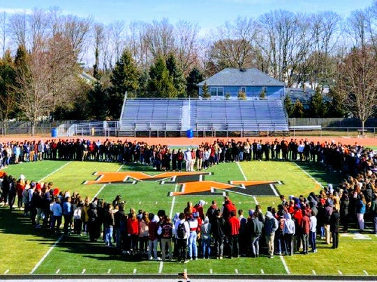 Students form a heart shape around the 50-yard line on the football field at Middletown North High School. The students were showing their support for the 17 students and staff that were murdered in Marjory Stoneman Douglas High School in Parkland, Florida a month ago Wednesday.