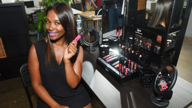 "Lip Bar founder Melissa Butler shows off her line of lipsticks, some of which were originally pitched on the TV show ""Shark Tank."" The sharks didn't invest in her start-up company, but Butler's business has more than doubled its revenue after the harsh rejection."