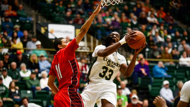 Dwight Smith, a former CSU guard, puts up a shot while being guarded by Lamar's Nimrod Hilliard during a Dec. 28, 2013, game.