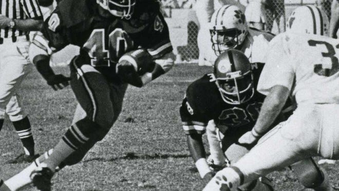 Russell Pope (40) starred for a Rockford East team that went 22-0 his last two years in high school, and rushed for 673 yards as a senior at Purdue, which won the Peach Bowl that year.