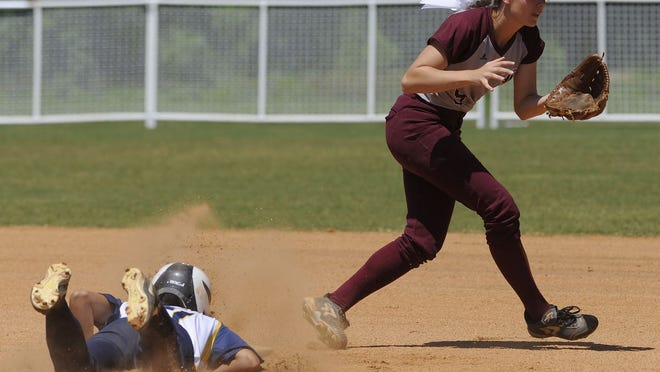 Mary Villageois of St. James slides safely into second as LAMP's Abigail Norris waits on the throw at Lagoon Park on Thursday.