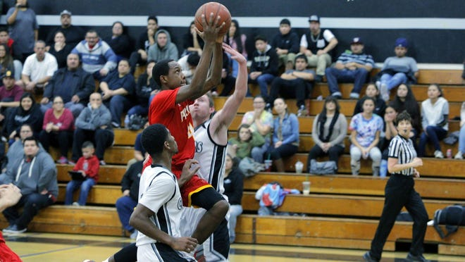 Palma High's Jamaree Bouyea scores past two North Monterey County defenders during a January game. Palma plays in the CIF Division IV state championship game today.