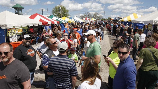 Attendees roam the various contestants' tents sampling barbecue at last year's Rock'n Ribs.