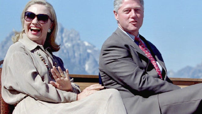 The Clintons appear at a ceremony at the Jackson Lake Lodge in the Grand Teton National Park in Wyoming on Aug. 26, 1995, marking the 75th anniversary of woman's suffrage in the U.S.
