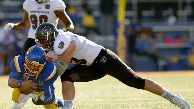 Missouri State's Dylan Cole stops South Dakota State's Taryn Christian during a Nov. 5 game in Brookings, South Dakota.