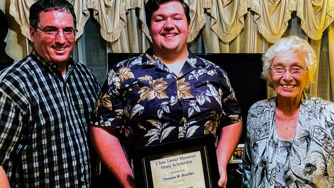 Michael Tanner, left along with his mother Rosalie Tanner, right present the Claus Tanner Memorial Music Scholarship to Thomas Stauffer, center.
