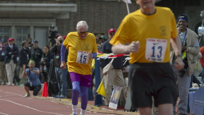 94-year-old George Scott (No. 13) and 98-year-old Champ Goldy (No. 15) compete in the Masters Men's 75 and older 100-meter dash at the Penn Relays.