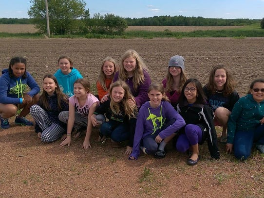 Troop 6181 went to check on their sweet corn back in