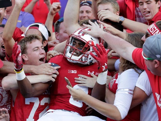 Wisconsin cornerback Sojourn Shelton celebrates the
