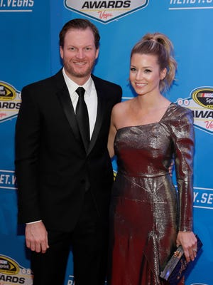 Dale Earnhardt Jr., left, and fiancée Amy Reimann pose on the red carpet before Friday's NASCAR Awards ceremony.