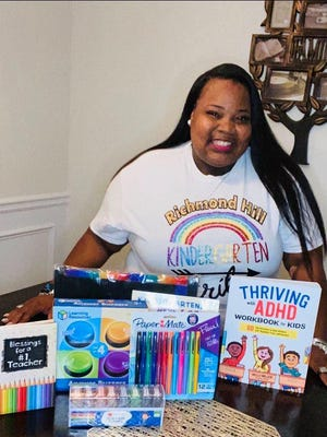 Tiffany Gillians, Kindergarten teacher at Richmond Hill K-8, with some of the school supplies purchased by donor Atiya Prince.