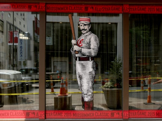 A rendering of a 19th century Cincinnati Reds player decorates the Renaissance Hotel in Downtown.