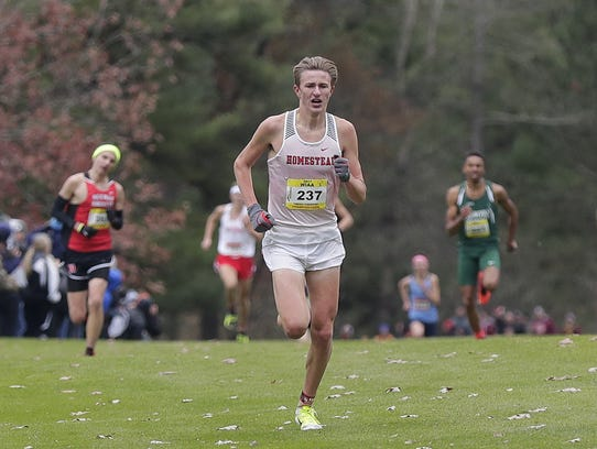 Drew Bosley of Homestead finishes in first place during the WIAA 2017 cross country state championship Boys division 1 race on Oct. 28 at Ridges Golf Course in Wisconsin Rapids.