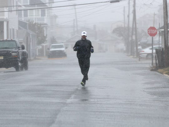 This jogger along Timber Lane in Manasquan Tuesday, March 14, 2017, can't be stopped by the driving rain.