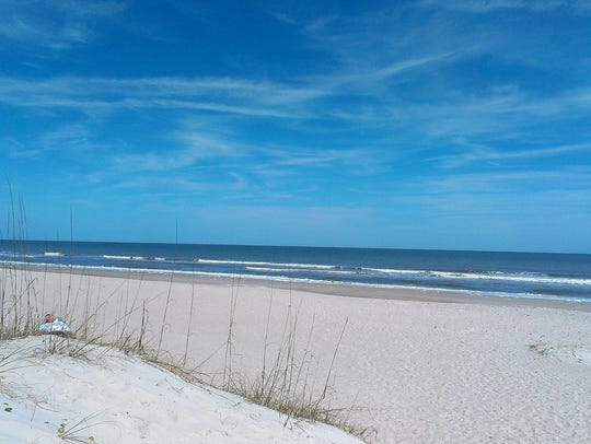 Dunes and white sand attract visitors to this beach