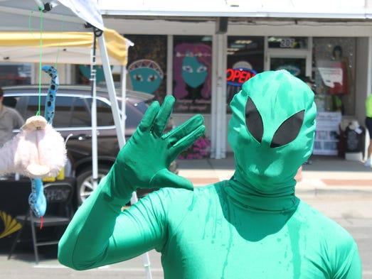 Festival-goers enjoy Thursday's UFO Festival in Roswell.