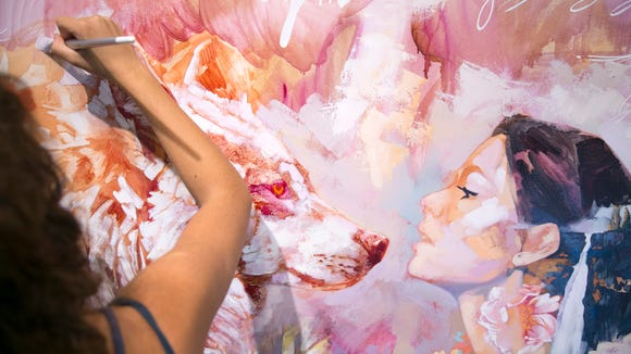Dimitra Milan, 16, works on an oil on canvas painting at her home studio in Queen Creek on Aug. 5, 2016.