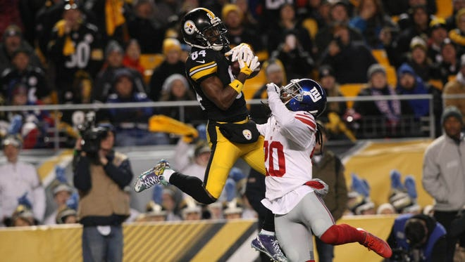 Pittsburgh Steelers wide receiver Antonio Brown (84) catches a touchdown pass over New York Giants cornerback Janoris Jenkins (20) during the first half at Heinz Field.
