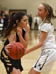 Galena's Kiana Arvizo passes the ball around Manogue's Jordyn Jensen after getting a the rebound during Tuesday's game at Bishop Manogue