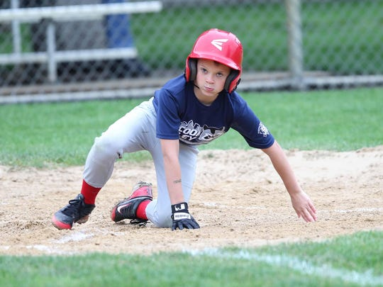 Red Sox player Baylor Pierce slides safely into home during a game with the Dodgers. This is the 60th anniversary season of the Raccoon Valley Little League. Mandatory