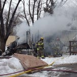 Firefighters battle North Liberty trailer fire