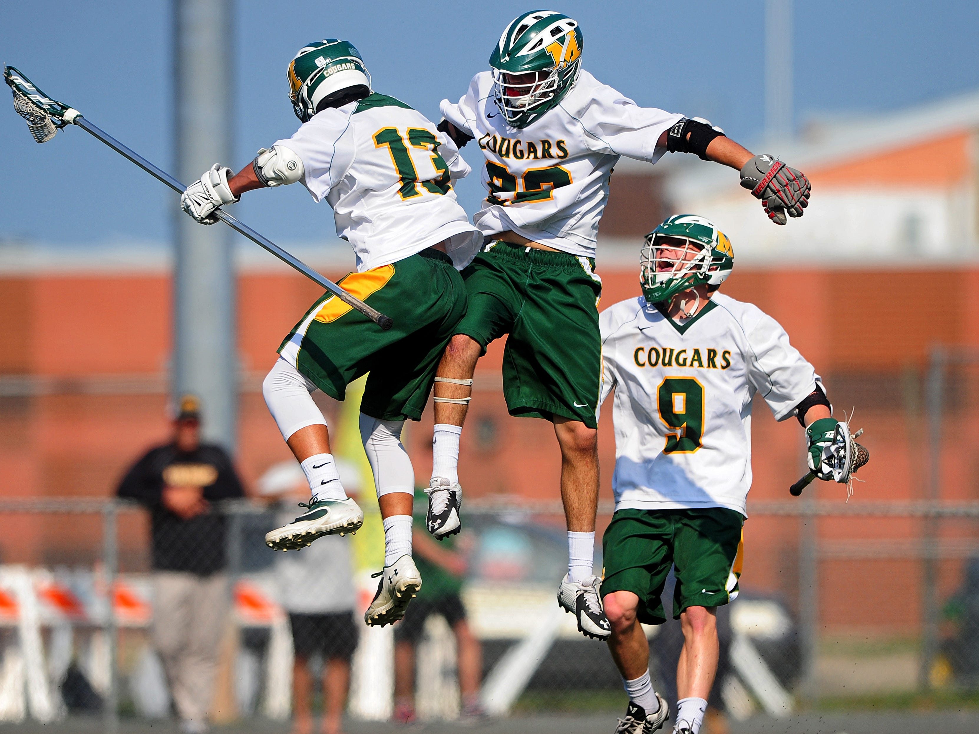 Lucas Goldoni, #13 of Montgomery, celebrates a buzzer-beating goal against Ridge in the first quarter with Matt Stagnitta, #22, and Cam Garinger, #9, during NJSIAA boys lacrosse first-round action on May 19, 2015 at Montgomery High School in Skillman, NJ. Will Schneekloth/Special to NJ State Media BRI 0520 BLAX Ridge at Montgomery