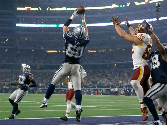 Dallas Cowboys outside linebacker Sean Lee (50) intercepts a pass in the end zone intended for Washington Redskins tight end Derek Carrier (89) during the second half of an NFL football game, Thursday, Nov. 24, 2016, in Arlington, Texas. (AP Photo/Michael Ainsworth)