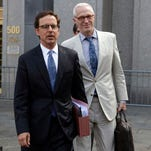 Carmine Boccuzzi, center, a lawyer representing Argentina, leaves federal court after a hearing, in New York,  Thursday, Aug. 21, 2014.