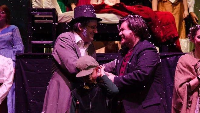"Nathan Williamson, left. as Scrooge and Dan Hall as Bob Cratchitt in Faith Presbyterian's production of ""A Christmas Carol."""