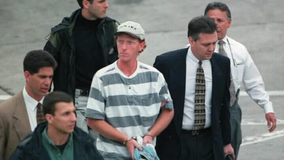 David Scott Ghantt is led from a US Airways plane at Charlotte Douglass Airport in 1998, following his arrest in Mexico.