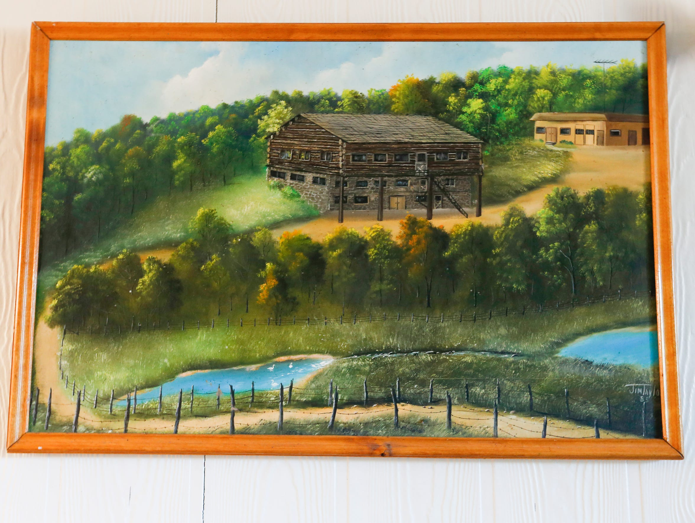 A painting hangs near the dining room at the Lives